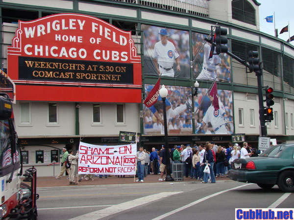 Protestors demonstrate in front of Wrigley Field in Chicago